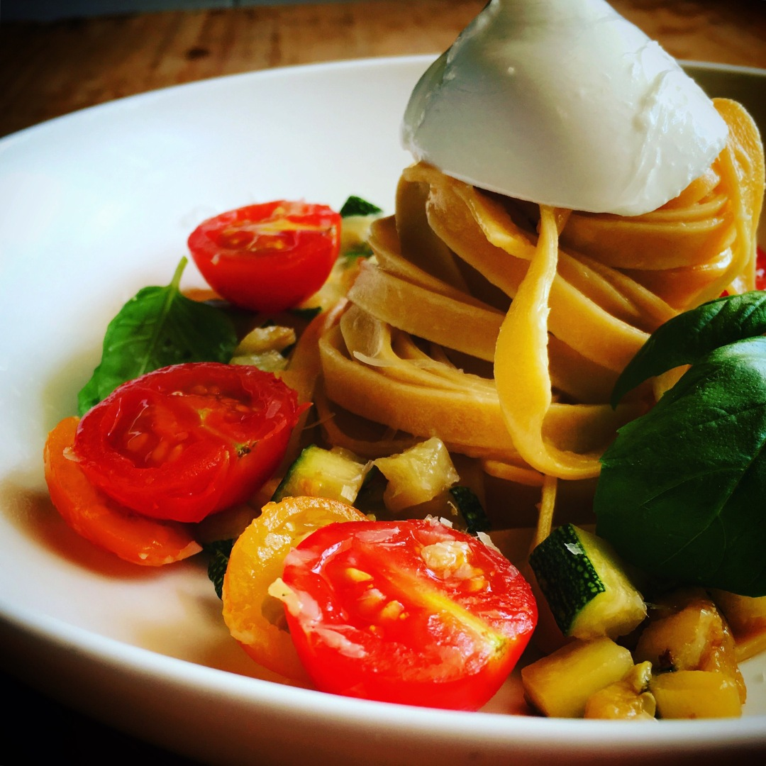 Homemade egg pasta with tomatoes and zuccini
