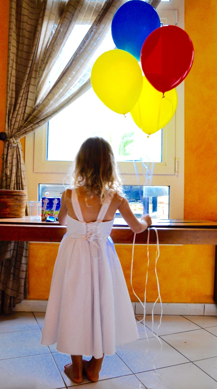 Girl and her ballons yellow blue red
