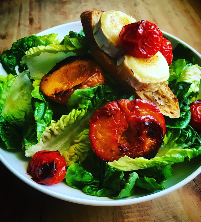Rosted tomatoes roasted peaches and warm goat's cheese salad