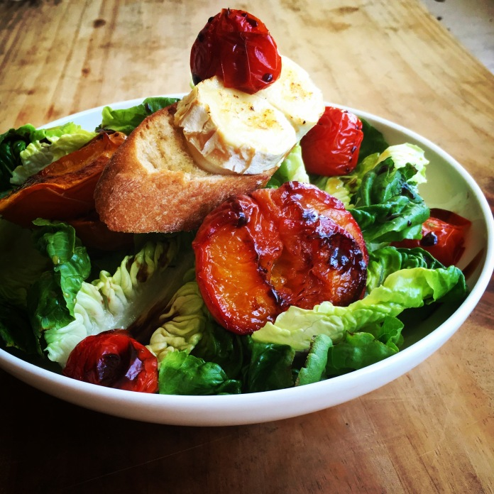 Warm chevre salad with peach, tomatoes and baby gems lettuce