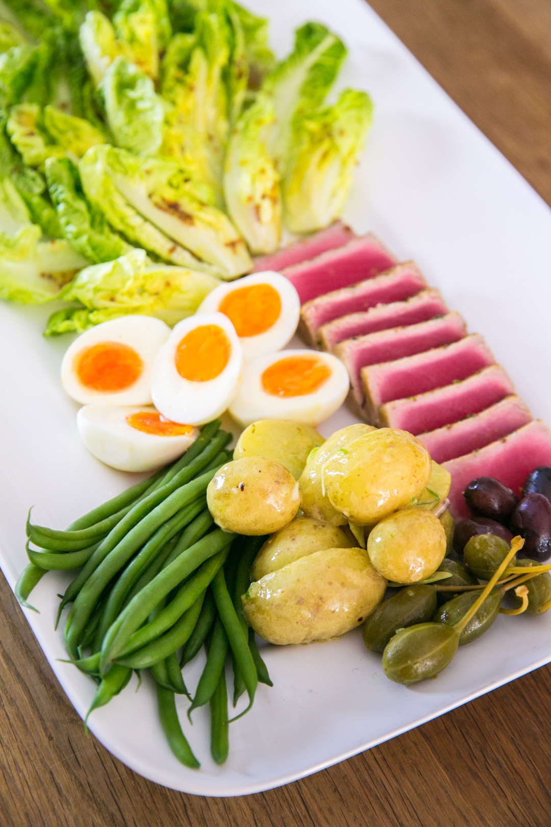 tuna nicoise platter with capers, potatoes, beans and eggs