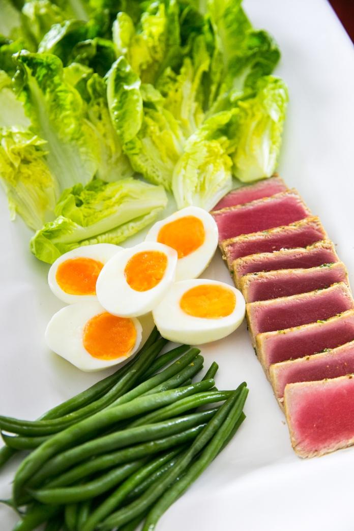 tuna nicoise with organic eggs, green beans, and lettuce