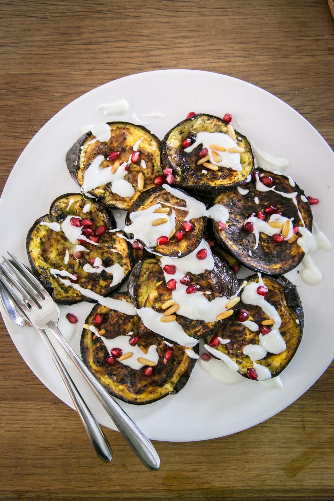 roasted eggplant with garlic yogurt sauce and fresh pomegranite