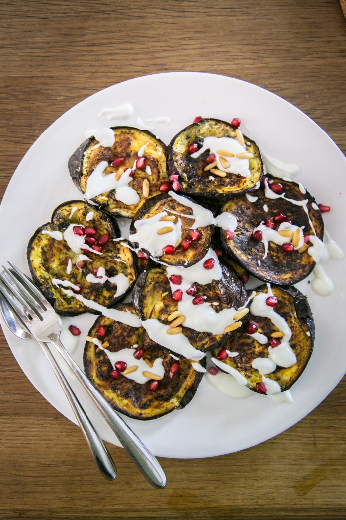 roasted eggplant with garlic yogurt sauce and fresh pomegranite