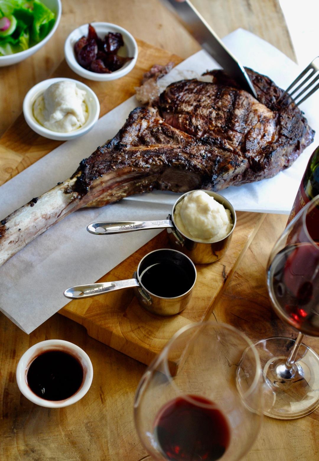 Cutting through a Tomahawk steak